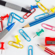 Pencil, pen, paperclips, sharpeners and pushpins on white desktop closeup — Stock Photo #48027285