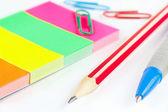 Multicolored school stationery on white desktop closeup — Stock Photo