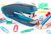 Stapler and multicolored stationery supplies on white desktop closeup — 图库照片