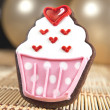 Foto Stock: Sweet cup cake cookie and balloons