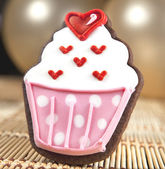 Sweet cup cake cookie and balloons — Stock Photo
