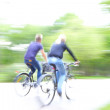 Riding bike on morning light through the park — Stock Photo