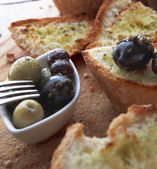 Olives and bread — Stock Photo