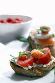 Canapes with salmon and cheese — Stock Photo