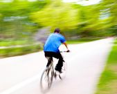 Riding Bike on Monday morning in the park — Stock Photo