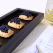 Stock Photo: Caviar and salmon canape for closed buisness