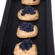 Stock Photo: Caviar and salmon canape in tray