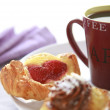 Coffee break with pastries — Stock Photo #35023695