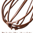 Whisk with melted chocolate over white — Stock Photo