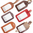 Collection of leather luggage tags isolated on white - Stock Photo