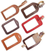 Collection of leather luggage tags isolated on white — Stock Photo