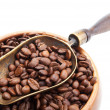 Stock Photo: Vintage scoop with coffee beans isolated on white