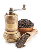 Vintage pepper mill and black peppercorn — Stock Photo