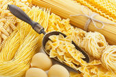 Retro still life with assortment of uncooked pasta — Stock Photo