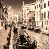 Gondolas on canal in Venice, Italy — Stock Photo