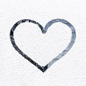 Heart drawn on frosty window. — Stock Photo