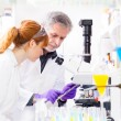 Health care professionals in lab. — Stock Photo #43779375