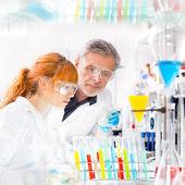 Health care professionals in lab. — Stock Photo
