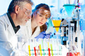 Health care professionals in lab. — Stock Photo
