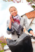 Woman riding bicycle. — Stock Photo