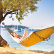 Lady reading book in hammock. — Stock Photo #45781165