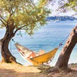 Lady reading book in hammock. — Stock Photo