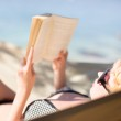 Lady reading a book in a hammock. — Stock Photo