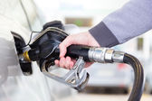 Petrol being pumped into a motor vehicle car. — Stockfoto