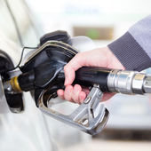 Petrol being pumped into a motor vehicle car. — Stock Photo