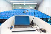 Laptop on the rostrum in conference hall. — Stockfoto
