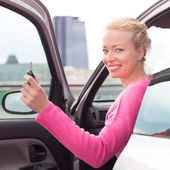 Woman driver showing car keys. — Stock Photo