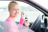 Woman driver showing car keys. — Stock Photo