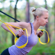 Training with fitness straps outdoors. — Foto Stock #47174181