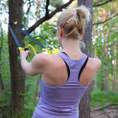 Training with fitness straps outdoors. — Stock Photo
