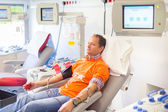 Blood donor at donation. — Stock Photo