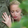 Young woman hugging a tree. — Stock Photo #47213887