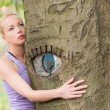Young woman hugging a tree. — Stock Photo #47217883