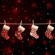 Vector hanging christmas socks on a clothesline - Stock Vector