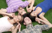 Lying on grass — Stock Photo