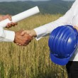 Stock Photo: Engineers handshaking