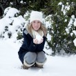 Girl in snowy landscape — Stock Photo