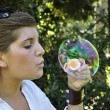 Young girl blowing bubbles — Stok fotoğraf