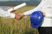 Engineers handshaking — Stock Photo