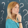 Stock Photo: Woman and question mark