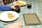 Tablet anf food — Stock Photo