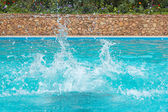 Water splashes in the swimming pool — Stock Photo