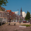 Street with canal of Delft - Stock Photo