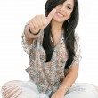 Closeup portrait of a beautiful young woman showing thumbs up si — Stock Photo #11703534