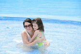 Mother and her baby having fun in the swimming pool. — Stock Photo
