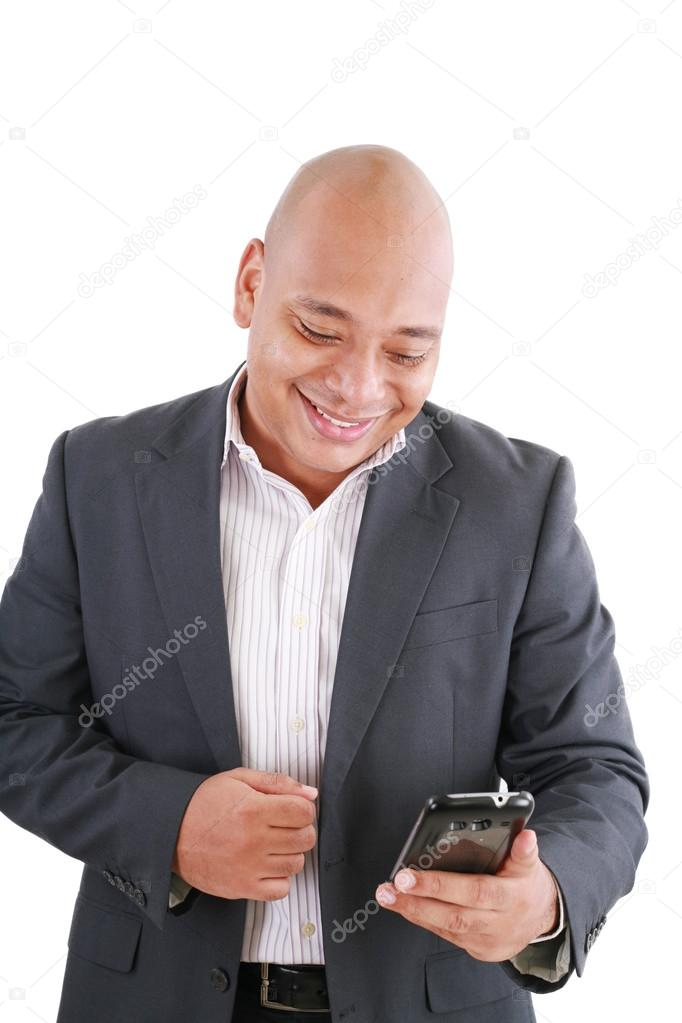 Portrait of an African American businessman text messaging   Stock Photo #12661164